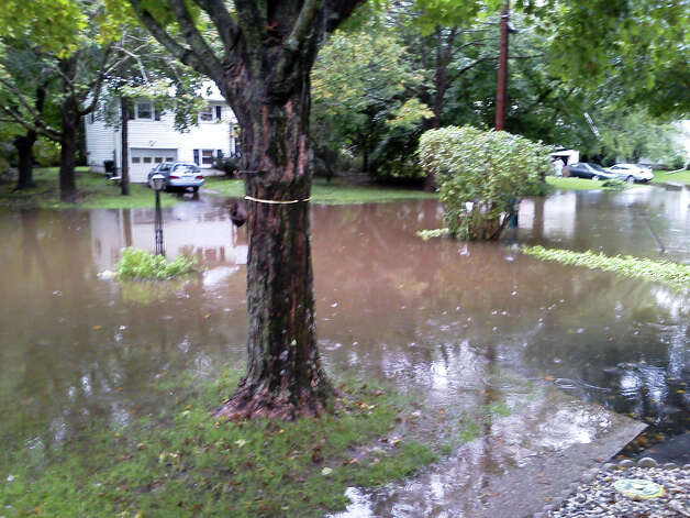 This is a photo of flooding in the Meadowbrook Manor neighborhood of Brookfield in September 2012. Residents appealed to the Board of Selectmen to take action, and selectmen said this is a high priority. Photo: Contributed Photo