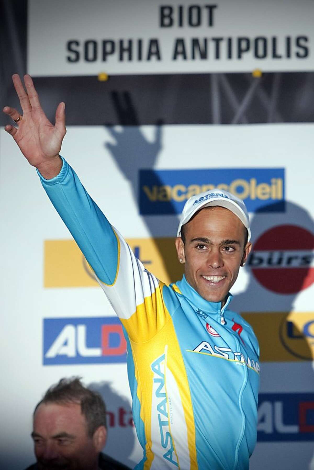 A file picture taken on March 12, 2011 shows French Remy Di Gregorio (Astana) waving on the podium after he won the 7th stage of the 69th Paris-Nice cycling race between Brignoles and Biot, southern France. Tour de France team Cofidis have suspended Di Gregorio over doping allegations, the team announced on July 10, 2012. AFP PHOTO LIONEL BONAVENTURELIONEL BONAVENTURE/AFP/GettyImages