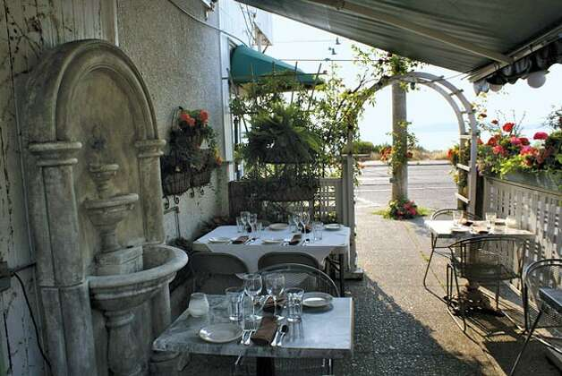 La Rustica: A true gem, this humble, lovely Italian spot has a flower-lined patio strewn with ivy and terra cotta pots that will transport you far, far away. You can gaze out for miles over Puget Sound at wooded islands and the snow-capped peaks of the Olympics as you twirl linguine di mare (mixed seafood pasta) onto your fork (all the pastas are tasty here). In authentic Italian fashion, you can taste the love. West Seattle, 4100 Beach Drive SW; 206.932.3020; larusticarestaurant.com For eight more fantastic restaurant patios, visit Seattle Magazine. PHOTO CREDIT:                        Couretesy of La Rustica Photo: Seattle Magazine