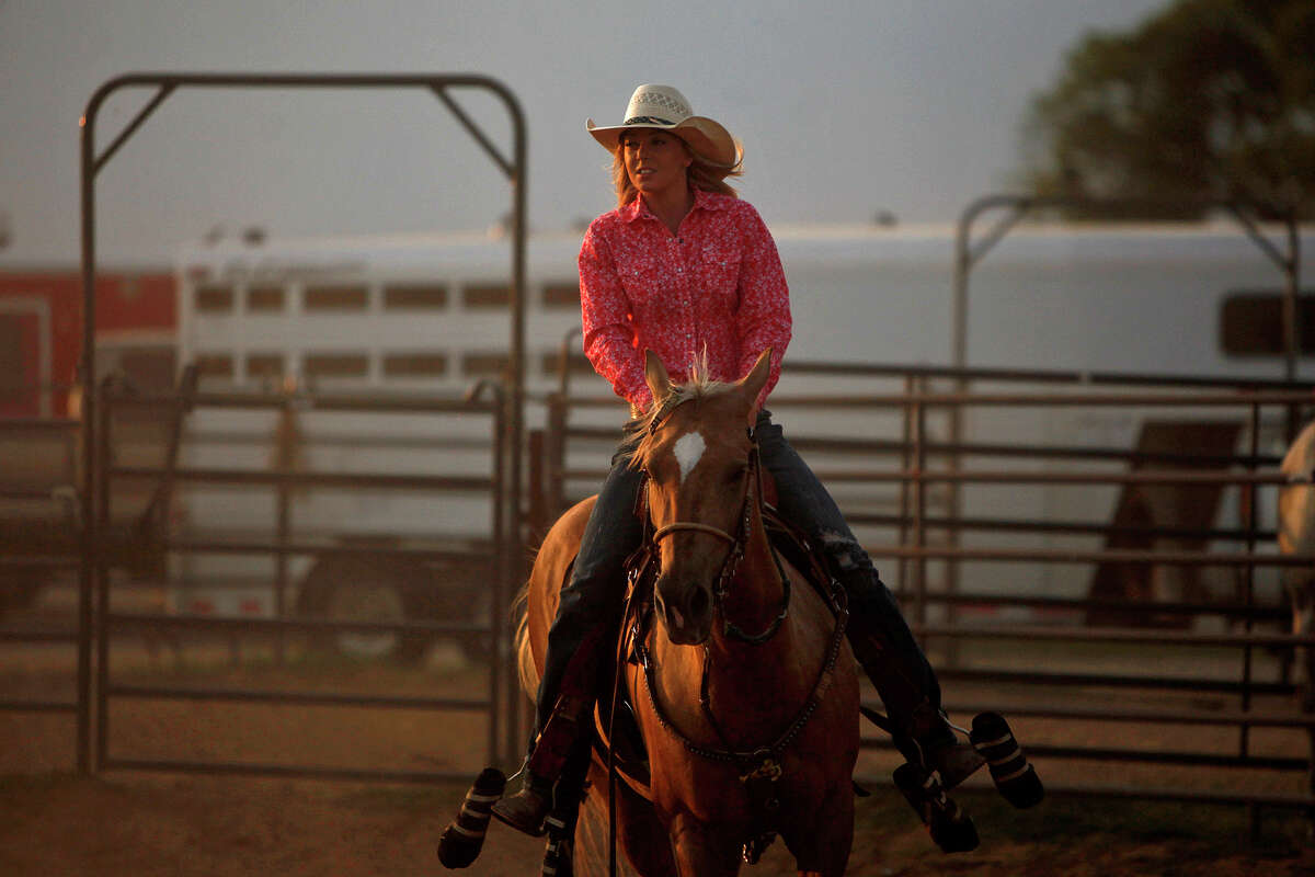 Sidney Gibson, 18, warms up her horse, Miss Beacon's Blondie, during the weekly Open Pro Rodeo at the Tejas Rodeo Company in Bulverde on Saturday, July 7, 2012.