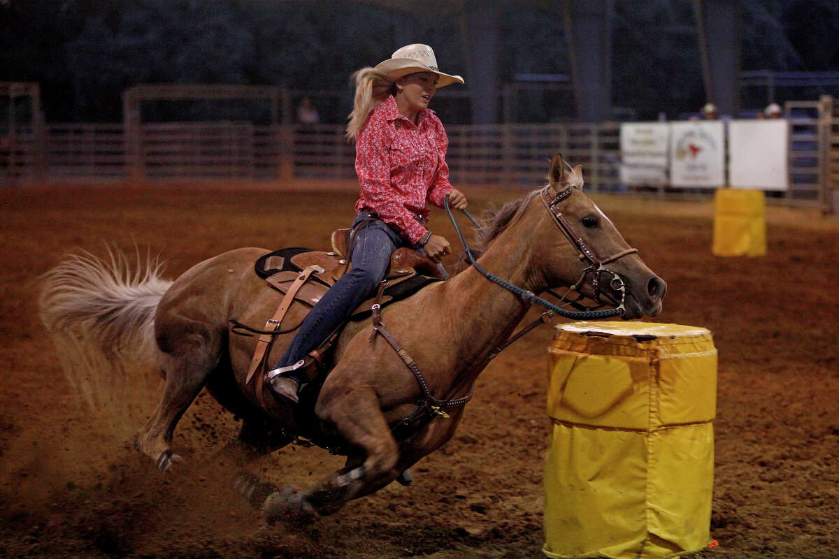 Sidney Gibson, 18, of Pipe Creek competes with Miss Beacon's Blondie in barrel racing in Bulverde last week. Gibson will represent Texas at the high school national championships this month in Wyoming.