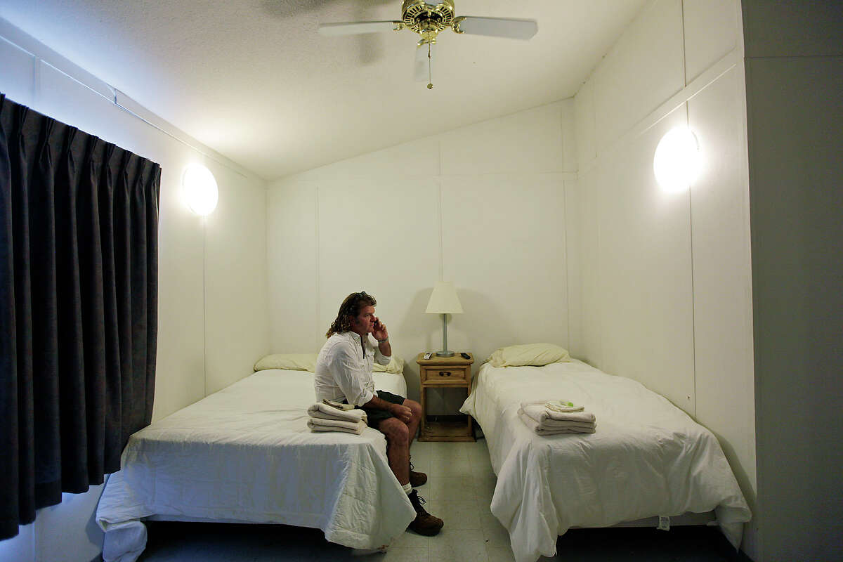 Signor Group's John Pettit sits in modular quarters near Carrizo Springs last year. A study calls for more housing in areas near Eagle Ford drilling sites, including Carrizo Springs.