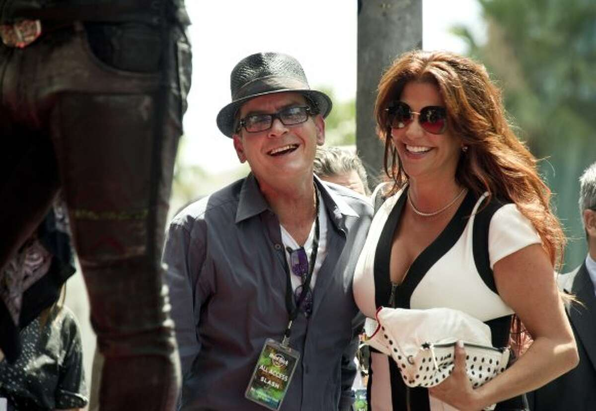 Actor Charlie Sheen and Perla Ferrar, wife of musician and songwriter Slash, watch as Slash is a honored with a Star on the Hollywood Walk of Fame on July 10, 2012 in Hollywood, California. (JOE KLAMAR / AFP/Getty Images)