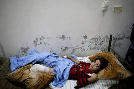 Raghad Jihad Borghol, 10, recovers from surgery at home after she was wounded and lost a leg in the explosion of a shell dropped by an army helicopter in Kfar Nubul in the northwestern province of Idlib on July 8, 2012. International envoy Kofi Annan has arrived in Syria after admitting that his peace plan has so far failed to end nearly 16 months of carnage, as scores more die in the violence-wracked country. AFP PHOTO/LOLO/AFP/GettyImages