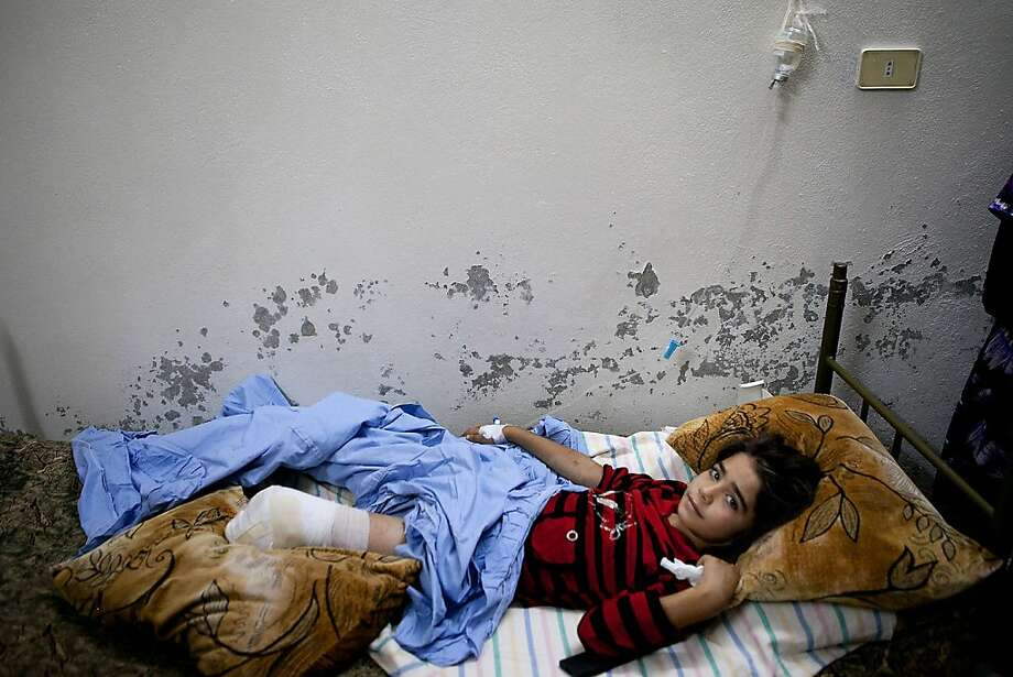 Raghad Jihad Borghol, 10, recovers from surgery at home after she was wounded and lost a leg in the explosion of a shell dropped by an army helicopter in Kfar Nubul in the northwestern province of Idlib on July 8, 2012. International envoy Kofi Annan has arrived in Syria after admitting that his peace plan has so far failed to end nearly 16 months of carnage, as scores more die in the violence-wracked country. AFP PHOTO/LOLO/AFP/GettyImages Photo: Lo, AFP/Getty Images