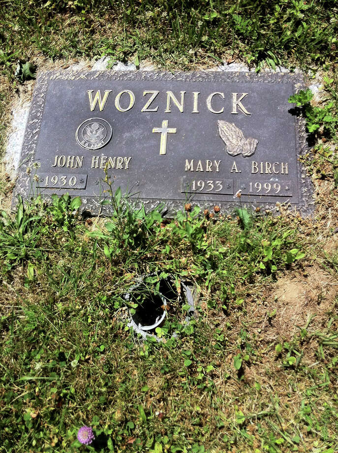 John Henry Woznick's wife Mary is buried at St. Michael's Cemetery in Stratford. He's angry that the bronze vase that he regularly put flowers in every time he visited her grave was stolen. Woznick wants his wife's bronze vase replaced (as cemetery officials promise In Your Corner they will do) and he wants better security in the form of surveillance cameras and patrols to ward off thieves and vandals. Photo: MariAn Gail Brown, MariAn Gail  Brown / Connecticut Post