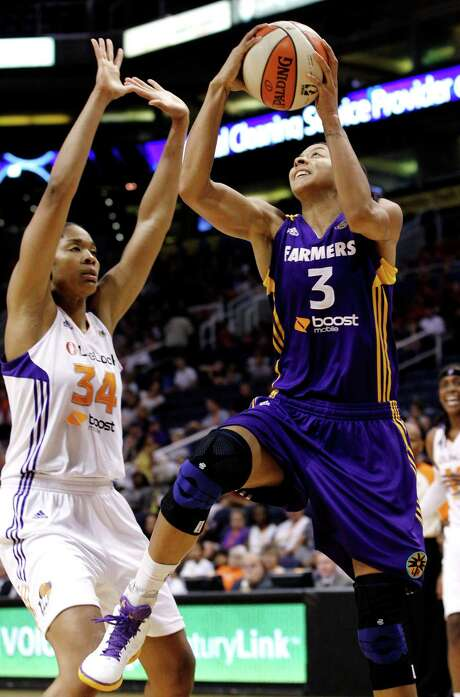 Candace Parker (right) netted 22 points and 14 rebounds as the Sparks beat the Mercruy and moved a game ahead of the Silvers Stars for second place in the Western Conference. Photo: AP