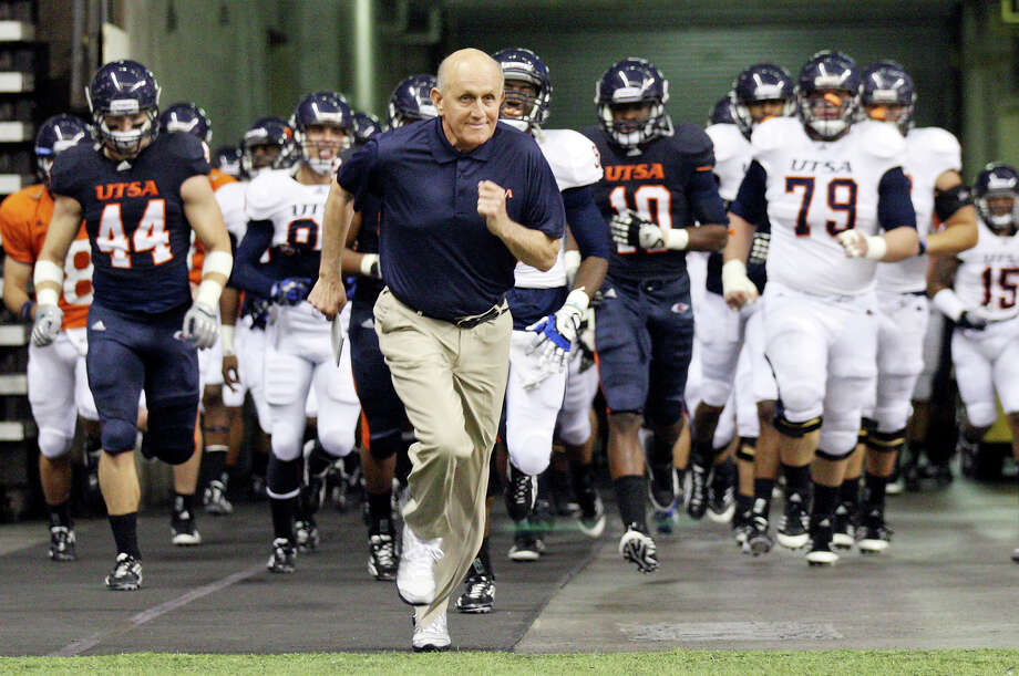 FOR SPORTS - UTSA head football coach Larry Coker leads the team onto the field before the 2012 UTSA Football Fiesta Spring Game held Sunday April 15, 2012 at the Alamodome. Photo: EDWARD A. ORNELAS, SAN ANTONIO EXPRESS-NEWS / © SAN ANTONIO EXPRESS-NEWS (NFS)