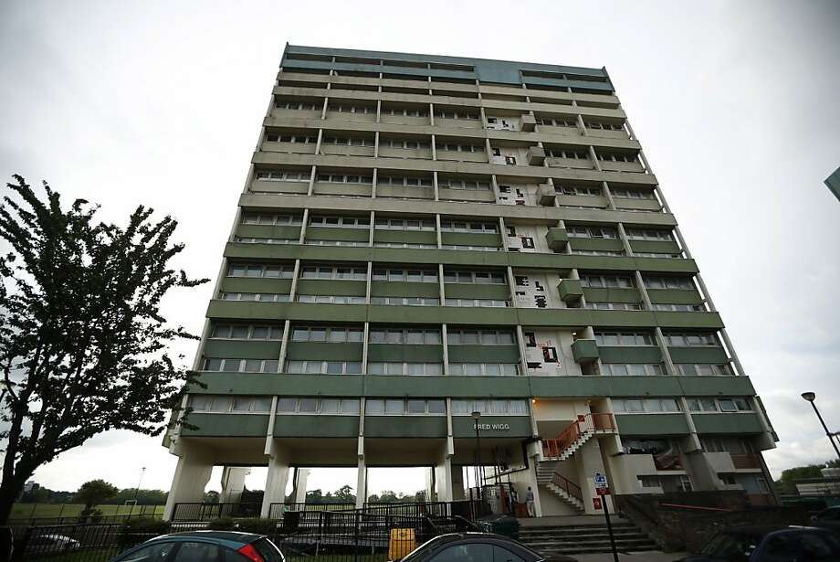 A general view shows the Fred Wigg Tower in Leytonstone, east London, Tuesday, July 10, 2012.  A judgement is due to be handed down Tuesday after residents of the London apartment tower went to court Monday in a bid to stop their rooftop from being used as a missile base during the upcoming Olympic Games, saying the deployment in a densely-populated area could make the building a terrorist target.  The British military plans to deploy surface-to-air missiles at six sites around London as part of a vast security operation for the July 27-Aug. 12, 2012 London Olympic Games, but residents of the 17-storey tower block say they were not consulted about the plans.(AP Photo/Matt Dunham) Photo: Matt Dunham, Associated Press