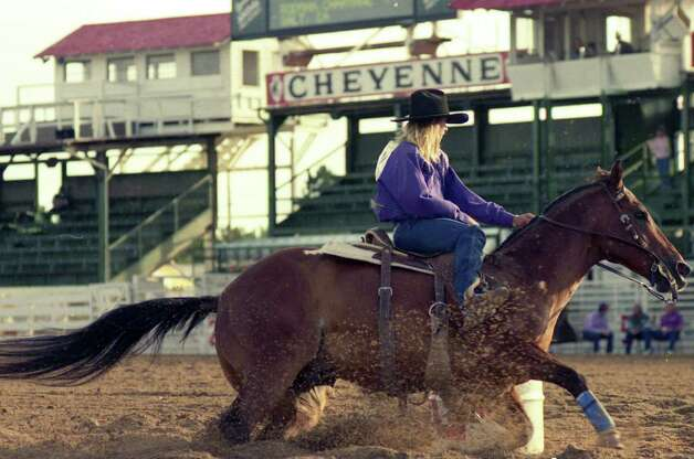 Barrel racer Scamper, who died July 4th, is put through his paces by owner Charmayne James. Photo: Courtesy Photo / John Brasseaux