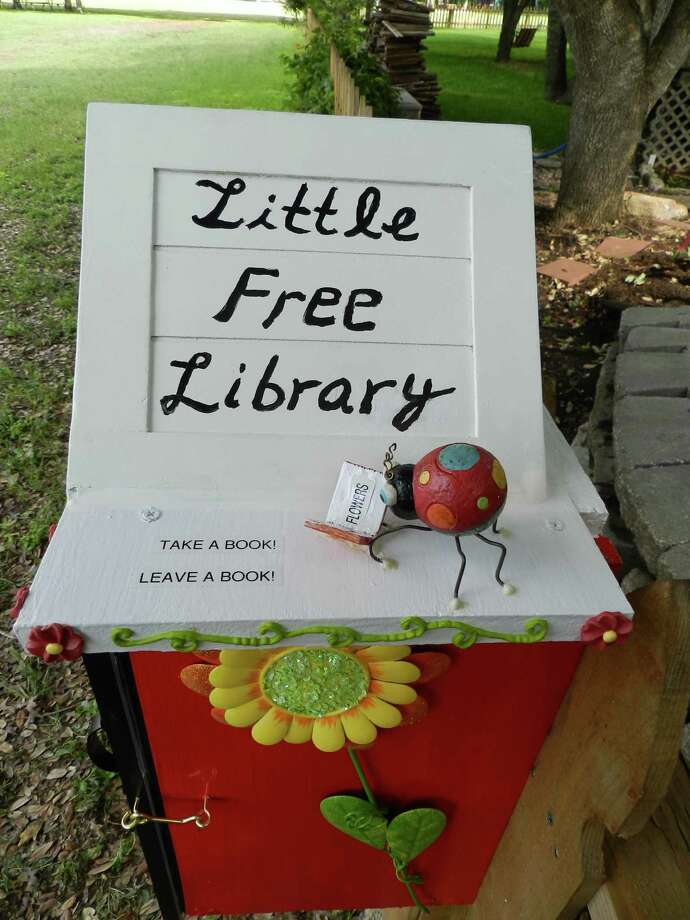Christa Neumann and her husband, Mark Gibson, who live in Pflugerville, were quick converts to the Little Free Library concept. Here s how it works: You take a sturdy, waterproof small structure, fill it with books, set it up outside, add a sign ( take a book, leave a book  is popular) and watch what happens. Photo: Christa Neumann