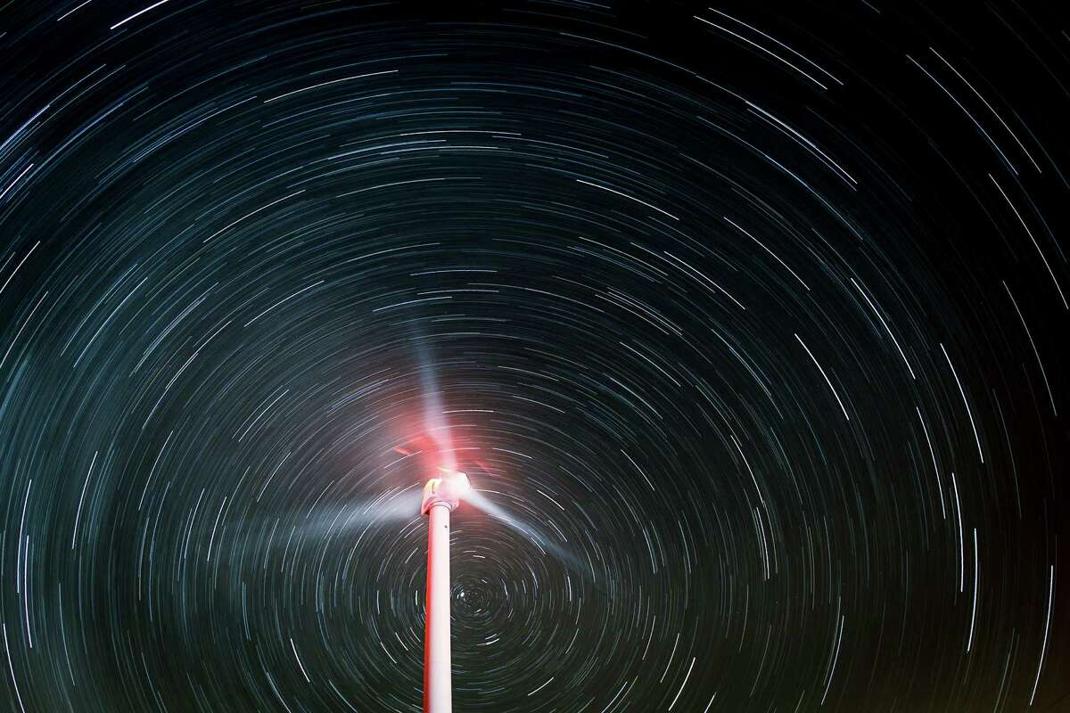 Star trails illuminate the sky as a wind turbine generates electricity during a 60-minute exposure at the BP Sherbino Mesa II Wind Farm, Sunday, Feb. 19, 2012, in Fort Stockton. After cutting its solar program last year, BP is beefing up its investments into wind energy and recently launched its fourth Texas wind farm, in Fort Stockton. On 20,000 acres in Pecos County, the Sherbino II farm has 60 wind turbines to generate enough electricity to power more than 175,000 homes.