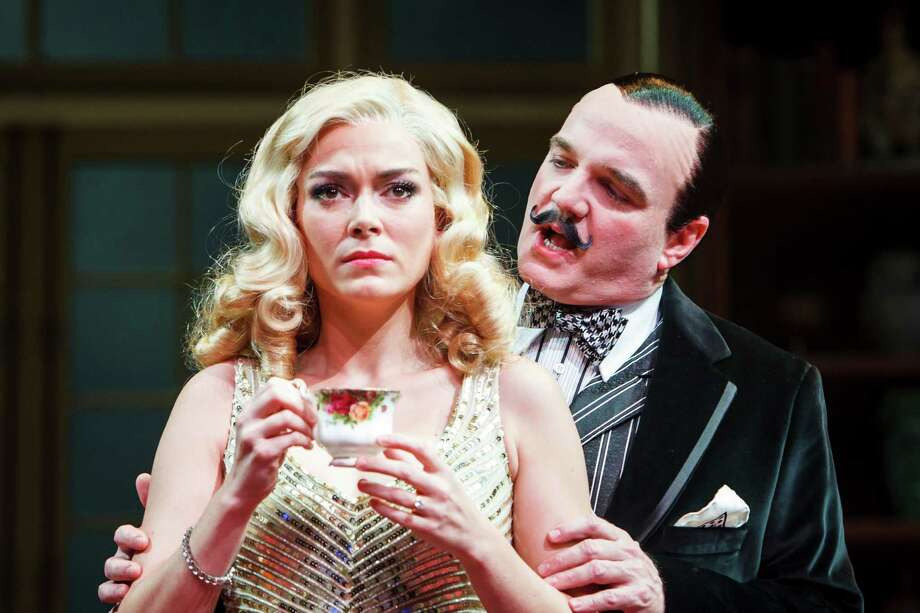 Laura Campbell as Lucia Amory, left, and James Black as Agatha Christie's famous sleuth Hercule Poirot in the Alley Theatre's production of Agatha Christie's mystery Black Coffee, Tuesday, July 3, 2012, in Houston. ( Michael Paulsen / Houston Chronicle ) Photo: Michael Paulsen / © 2012 Houston Chronicle