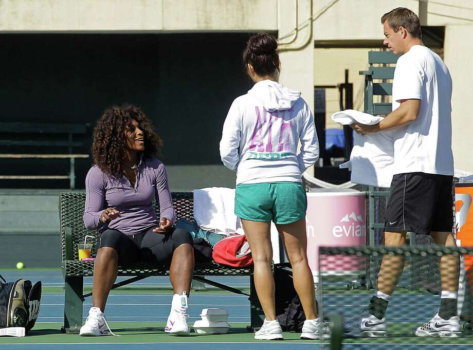 Wimbledon champion Serena Williams (left) was already back at it Tuesday during a practice session for the Bank of the West Classic. Photo: AP