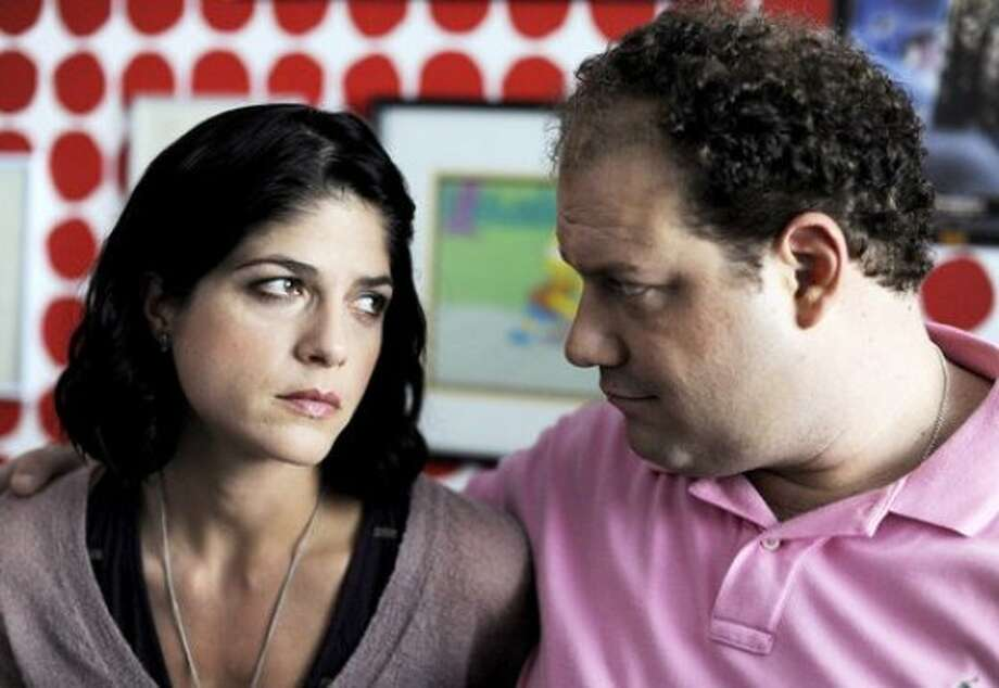 "Underachiever Abe (Jordan Gelber), who lives with his parents and collects toys, falls for a disturbed women (Selma Blair) who is the dark horse of her family in ""Dark Horse."" Photo: Brainstorm Media"
