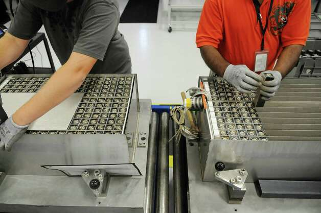 GE employees put together the company's durathon battery  in the new battery plant on Tuesday, July 10, 2012 at the GE campus in Schenectady, NY.   (Paul Buckowski / Times Union) Photo: Paul Buckowski