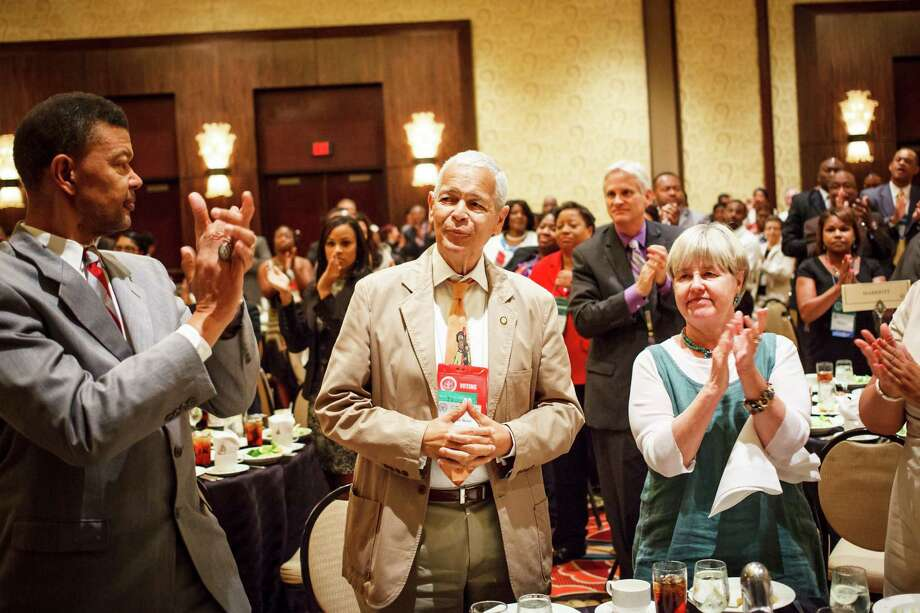 Social activist and leader in the American civil rights movement Julian Bond, center, receives a standing ovation during the Clarence Mitchell Jr. Memorial Lecture Luncheon at the 103rd NAACP Convention at the Hilton Americas Hotel, Monday, July 9, 2012, in Houston. Photo: Michael Paulsen, Houston Chronicle / © 2012 Houston Chronicle