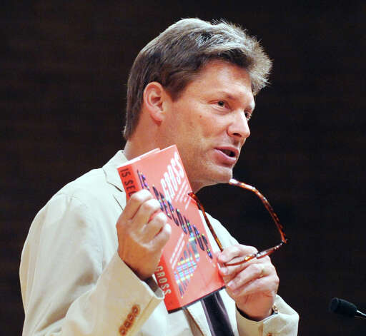 "Andrew Gross of Purchase, N.Y., holds up his new novel ""15 Seconds,"" at Greenwich Library, Tuesday night, July 10, 2012. Photo: Bob Luckey / Greenwich Time"