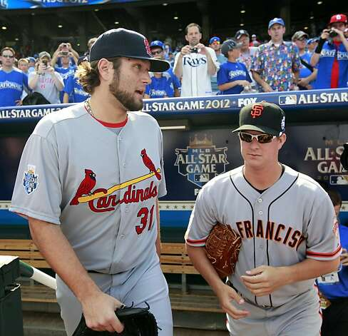 National League's Lance Lynn, of the St. Louis Cardinals, and Matt Cain, of the San Francisco Giants, walk out on the field to work out before the MLB All-Star baseball game, Tuesday, July 10, 2012, in Kansas City, Mo. Photo: Jeff Roberson, Associated Press