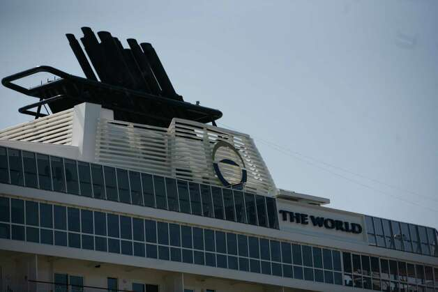 The World, the largest privately owned residential yacht on earth, is shown docked at Pier 66 in Seattle on Tuesday, July 10, 2012. There are 165 privately owned residences aboard The World ship. Photo: Sofia Jaramillo / SEATTLEPI.COM