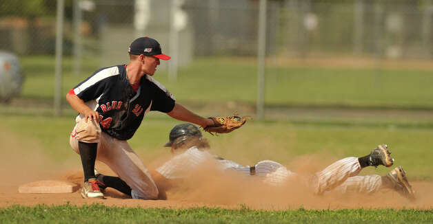 Danbury's Micheal Thomas slides into second just under the tag of Holyoke's Evan Potter during the Westerners' second game of their double-header against Holyoke at Rogers Park in Danbury on Tuesday, July 10, 2012. Danbury won, 5-2. Photo: Jason Rearick / The News-Times
