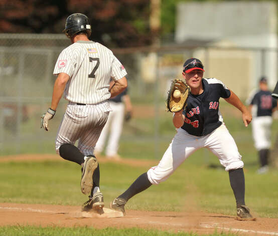 Danbury's Andrew Garner beats the throw to first baseman Joel Klock during the Westerners' second game of their double-header against Holyoke at Rogers Park in Danbury on Tuesday, July 10, 2012. Danbury won, 5-2. Photo: Jason Rearick / The News-Times