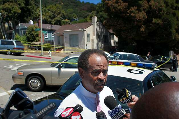 Larry Reid, President of the Oakland City Council, talks with the media at the corner of Kuhnle and Mountain Blvd., where police were investigating a dead body on Tuesday July 10, 2012, in Oakland, Calif. The victim was shot earlier in the day as he was said to be breaking up a fight at 82nd and Birch Street. Photo: Lacy Atkins, The Chronicle