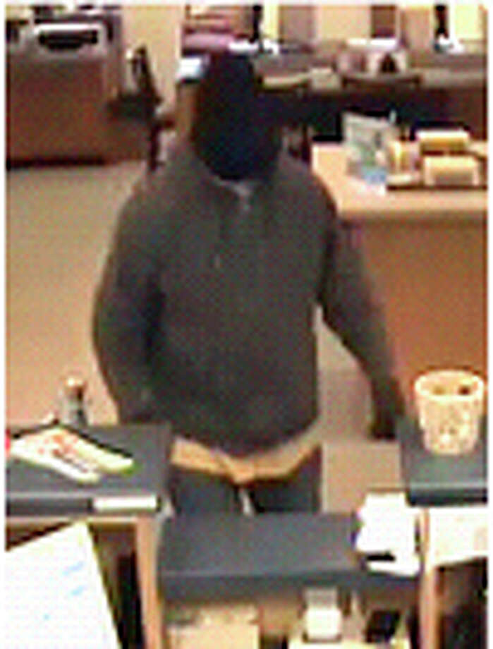 This photo was taken from a bank surveillance camera during a bank robbery at the Naugatuck Savings Bank in Southbury on April 20, 2011. Photo: Contributed Photo