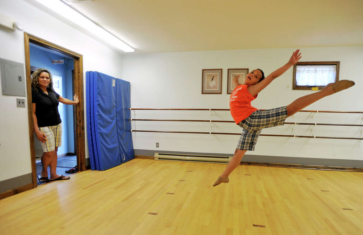 Ana Bernardino, left, watches her 9-year-old son, Mckenzie Bernardino, demonstrate a sissone, a ballet move, at Academy of Dance Arts in Brookfield on Tuesday, July 10, 2012.