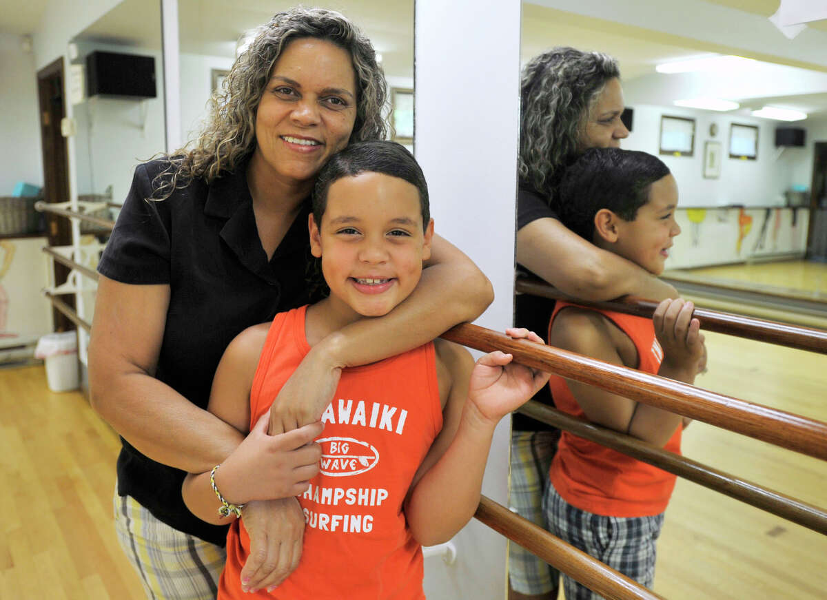 Ana Bernardino holds her 9-year-old son, Mckenzie Bernardino, by a mirror at Academy of Dance Arts in Brookfield on Tuesday, July 10, 2012. Three years ago Mckenzie was awarded a full scholarship to attend the School of American Ballet in New York City, which he has been able to do with his mother's help.