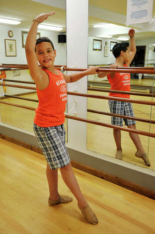 Mckenzie Bernardino, 9, demonstrates a tendu, a ballet position, at Academy of Dance Arts in Brookfield on Tuesday, July 10, 2012. Photo: Jason Rearick / The News-Times