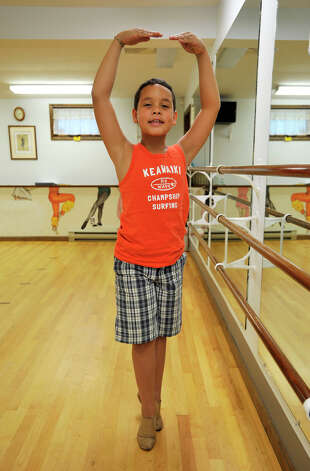 Mckenzie Bernardino, 9, demonstrates a balance in fifth position at Academy of Dance Arts in Brookfield on Tuesday, July 10, 2012. Photo: Jason Rearick / The News-Times