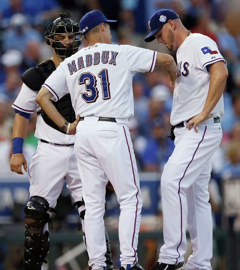 Matt Harrison (right) of the Rangers didn't help the American League's effort in Tuesday's all-star game by giving up three runs in the fourth. Photo: AP
