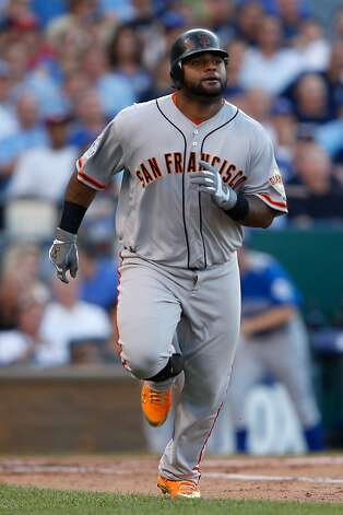 Pablo Sandoval hits a triple at Kauffman Stadium in Kansas City. Photo: Jamie Squire, Getty Images
