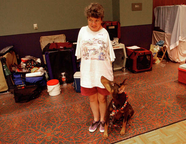 Donna Rock waits with Annie the Doberman Pinscher moments before running the agility course at the River City Cluster of Dog Shows on July 10, 2004 at the Convention Center. Photo: San Antonio Express-News File Photo / SAN ANTONIO EXPRESS-NEWS