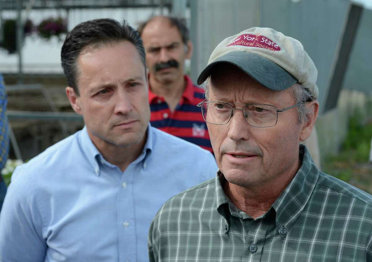 Assemblyman Pete Lopez, left listens to farm owner Richard Ball as he discusses the proposed pipeline in Schoharie County July 10, 2012 at a press conference at his Schoharie Valley Farm in Schoharie, N.Y. (Skip Dickstein / Times Union)