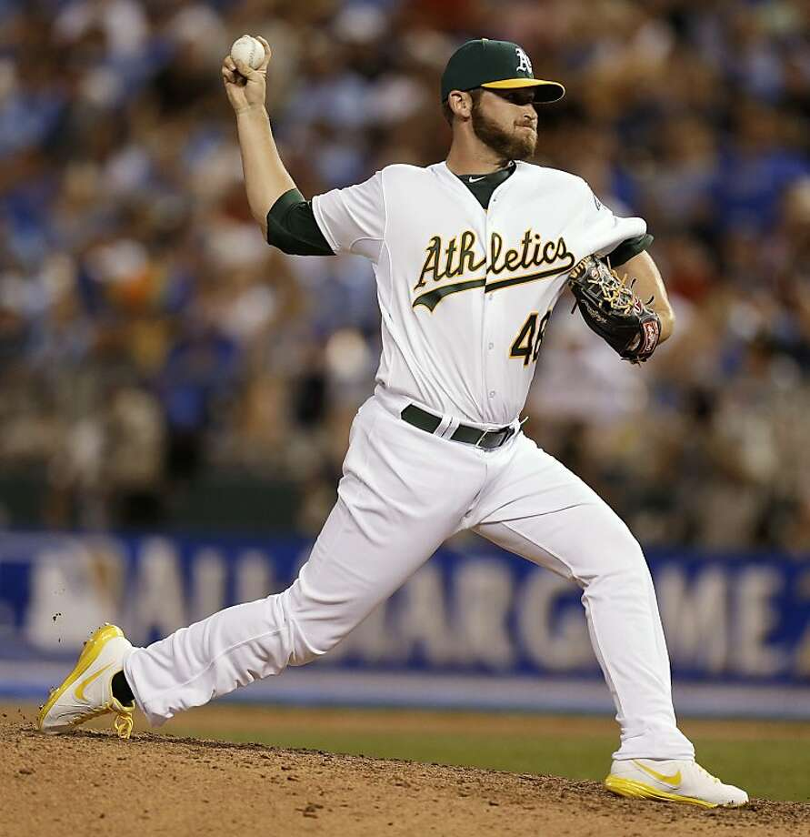 American League's Ryan Cook, of the Oakland Athletics, pitches during the seventh inning of the MLB All-Star baseball game, Tuesday, July 10, 2012, in Kansas City, Mo. (AP Photo/Jeff Roberson) Photo: Jeff Roberson, Associated Press