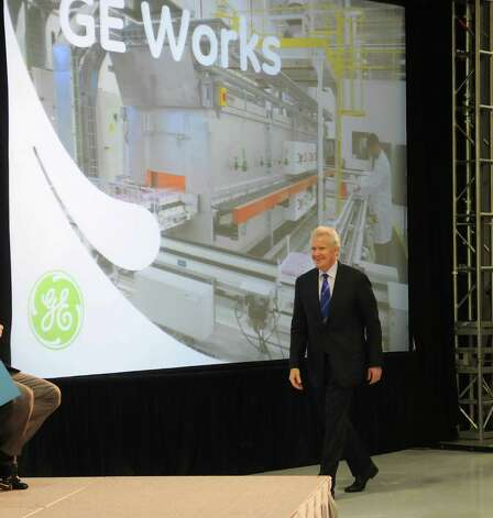 Jeffrey Immelt, GE chairman and CEO, makes his way to the stage at the opening of the company's new battery plant on Tuesday, July 10, 2012 at the GE campus in Schenectady, NY.  The plant will use GE's durathon battery technology in manufacturing  batteries for industry.  (Paul Buckowski / Times Union) Photo: Paul Buckowski