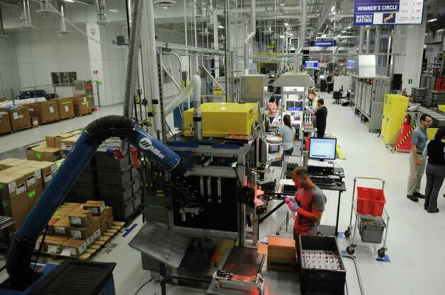 GE employees work in the company's  new battery plant on Tuesday, July 10, 2012 at the GE campus in Schenectady, NY.   (Paul Buckowski / Times Union) Photo: Paul Buckowski