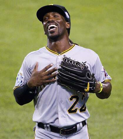 "Pittsburgh Pirates outfielder Andrew McCutchen sings Garth Brooks' ""Friends in Low Places"" along with the crowd in the sixth inning in the MLB All-Star Game on Tuesday, July 10, 2012, at Kauffman Stadium in Kansas City, Missouri. The National League won, 8-0. (Mike Ransdell/Kansas City Star/MCT) Photo: Mike Ransdell, McClatchy-Tribune News Service"