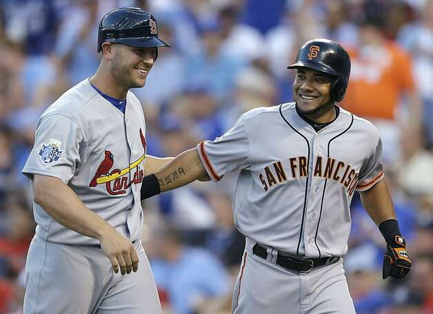 National League's Melky Cabrera, right, of the San Francisco Giants, celebrates his two-run home run with Matt Holliday, of the St. Louis Cardinals, during the fourth inning of the MLB All-Star baseball game, Tuesday, July 10, 2012, in Kansas City, Mo. (AP Photo/Jeff Roberson) Photo: Jeff Roberson, Associated Press