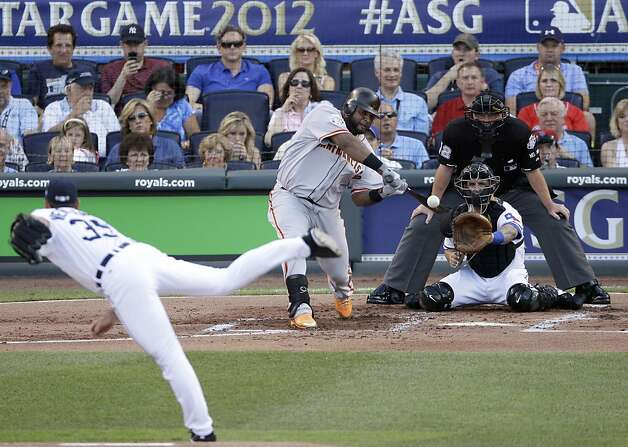 National League's Pablo Sandoval, of the San Francisco Giants, hits a three-run triple on a pitch by American League's Justin Verlander, of the Detroit Tigers, in the first inning the MLB All-Star baseball game Tuesday, July 10, 2012, in Kansas City, Mo. (AP Photo/Charlie Neibergall) Photo: Charlie Neibergall, Associated Press