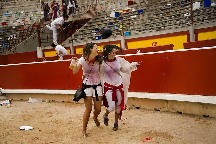 Revelers dance in the arena after a bullfight of the San Fermin festival, in Pamplona, Spain, Tuesday, July 10, 2012.(AP Photo/Daniel Ochoa de Olza) Photo: Daniel Ochoa De Olza, Associated Press