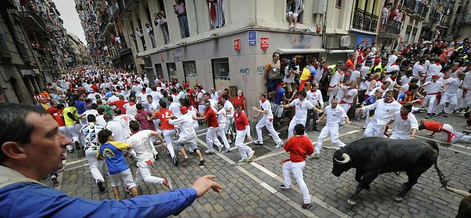 A runner falls in front of El Pilar bulls during the fourth run of the bulls of the San Fermin festival, on July 10, 2012, in the northern Spanish city of Pamplona. The festival is a symbol of Spanish culture that attracts thousands of tourists to watch the bull runs despite heavy condemnation from animal rights groups . AFP PHOTO/Pedro ARMESTREPEDRO ARMESTRE/AFP/GettyImages Photo: Pedro Armestre, AFP/Getty Images