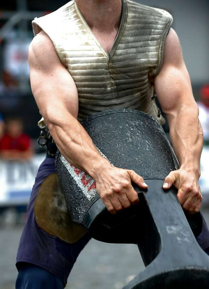 Stone lifter Josetxo Urrutia lifts a stone during a rural Basque sports championship during the San Fermin Festival  on July 9, 2012, in the Northern Spanish city of Pamplona. AFP PHOTO / ANDER GILLENEAANDER GILLENEA/AFP/GettyImages Photo: Ander Gillenea, AFP/Getty Images