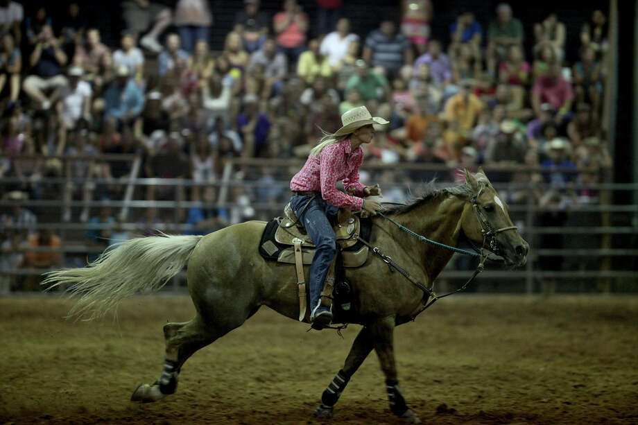 Horse and rider compete in barrel racing during the weekly open pro rode held every Saturday through November at the Tejas Rodeo Company in Bulverde. Photo: Lisa Krantz, San Antonio Express-News / San Antonio Express-News