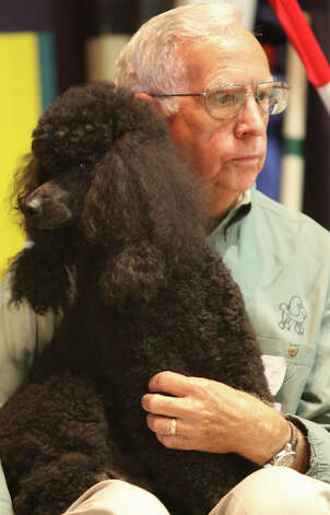 Harold Kohlman and Pokie the Miniature Poodle wait their turn during the jumpers and weaving competion at the River City Cluster of Dog Shows on July 14, 2007 at the Convention Center. Photo: San Antonio Express-News File Photo / SAN ANTONIO EXPRESS-NEWS