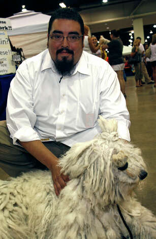 Chris Painter and Evie, a Komondor, at the River City Cluster of Dog Shows on July 11, 2009 at the Convention Center. Photo: J. Michael Short, For The Express-News / THE SAN ANTONIO EXPRESS-NEWS/210 SA