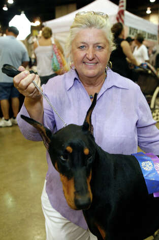 Kathy Drake with Justy, a Doberman Pinscher, at the River City Cluster of Dog Shows on July 11, 2009 at the Convention Center. Photo: J. Michael Short, For The Express-News / THE SAN ANTONIO EXPRESS-NEWS/210 SA