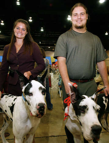 Carrie Woods and Zach Lawson with their Harlequin Great Danes, Slice and Toby, at the River City Cluster of Dog Shows on July 11, 2009 at the Convention Center. Photo: J. Michael Short, For The Express-News / THE SAN ANTONIO EXPRESS-NEWS/210 SA